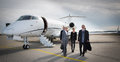 Executive business team leaving corporate jet Royalty Free Stock Photo