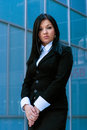 Executive woman poses in front of an office building Stock Photography
