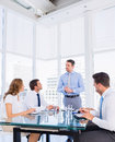 Executives sitting around conference table Royalty Free Stock Images