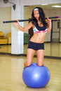 Exercise ball balancing Royalty Free Stock Images
