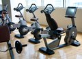 Exercise bikes a row of in upscale gym Stock Image