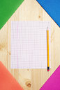 Exercise books and a single clean sheet multicolored on table Royalty Free Stock Photo