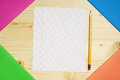 Exercise books and a single clean sheet multicolored on table Royalty Free Stock Image