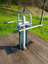 Exercise equipment in a park public sunny day Royalty Free Stock Photos