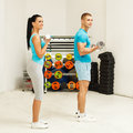 Exercise at the gym beautiful young woman and young man together Royalty Free Stock Images