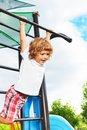 Exercise horizontal bar happy three years old boy about to hand on the on playground Royalty Free Stock Photos