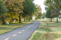 Exercise pathway two lane asphalt winding through gravelly point park in arlington virginia on autumn morning Royalty Free Stock Photos
