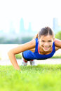 Exercise woman - push ups workout Stock Photography