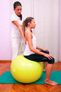 Exercises control basin trunk with bobath ball fitball stabiliza stabilization in studio Stock Photography