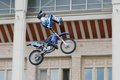 Exercising with a motorcycle russia moscow july motofristayler anton smirnov at the sports festival moscow city games in the Royalty Free Stock Photography