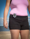 Exercising with a pedometer woman wearing walking on the beach Stock Images