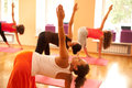 Exercising at yoga class Stock Photography