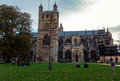 Exeter cathedral view of in england with people in the park in front of it Stock Photography