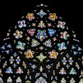 Stained Glass in Exeter Cathedral, West Window Top Circle Royalty Free Stock Photo