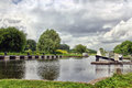 Exeter ship canal a view from double locks along the on a stormy summer s day Stock Photography