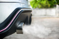 Exhaust from car,Smoke from a car producing pollution Royalty Free Stock Photo