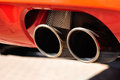 Exhaust pipe close up of a red car dual Royalty Free Stock Photos