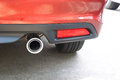 Exhaust pipe of a red car close up Royalty Free Stock Image