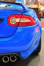 Exhaust, tail light and spoiler details of a Jaguar sports car Royalty Free Stock Photo