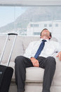 Exhausted businessman sleeping on couch Stock Image