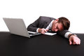 An exhausted businessman sleeping on his laptop Stock Images