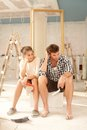 Exhausted couple in renovating home Stock Photo