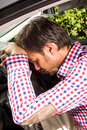 Exhausted driver resting on steering wheel of his car Royalty Free Stock Image