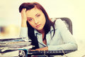 Exhausted female filling out tax forms Royalty Free Stock Photo