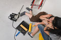 Exhausted female friends doing renovations taking a break and closing their eyes as they relax together on the floor to recover Stock Photo