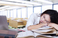 Exhausted teenage girl sleeping in class Royalty Free Stock Photo