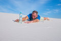 Exhausted traveler found a bottle of water and is delighted Royalty Free Stock Photo
