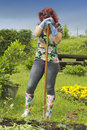 Exhausted woman gardener resting Royalty Free Stock Photo