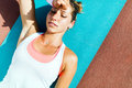Exhausted woman lying on a mat after exercise Royalty Free Stock Photo