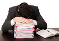 Exhausted worker sleeping on a pile of files isolated on white Stock Photography