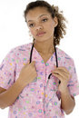 Exhausted Young Black Nurse in Scrubs over White Royalty Free Stock Photos