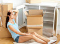 Exhausted young woman after unpack Stock Image