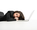 Exhaustion from overwork woman exhausted sleeping over computer Stock Image