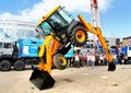 Exhibition gas oil technologies ufa russia may demonstration of of the jcb cx tractor abilities at the annual international on may Stock Photography