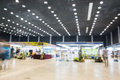 Exhibition hall blurred people walking Royalty Free Stock Images