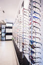 Exhibition of rims colorful eyeglasses at optician s store Royalty Free Stock Photos