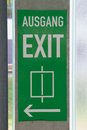 Exit green signpost with regard to lift Royalty Free Stock Images