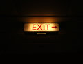 Exit sign on black background Stock Photography