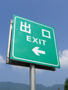Exit sign a green with arrow Stock Image