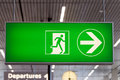 Exit sign green lit airport Royalty Free Stock Image
