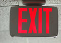 Exit sign lighted red direction Stock Photos
