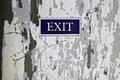 Exit sign on the old background Stock Photography