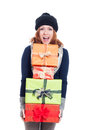 Exited woman with many presents in winter clothes holding isolated on white background Stock Photography