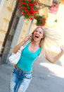 Exited woman with mobile phone Royalty Free Stock Photography