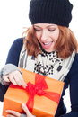Exited woman opening present closeup of winter Royalty Free Stock Image