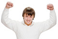 Exited young man raising clenched fist arm cheering her isolated on white Royalty Free Stock Image